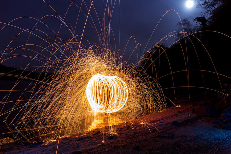 Spinning Wire Wool Against Sky At Night