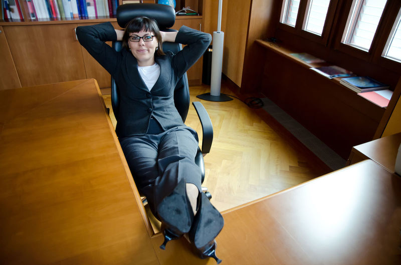Business woman relax in the office. Adults Only Arms Behind Head Business Businesswear Bussinesswoman Color Contemplation Cool Attitude Corporate Business Day Dreaming Distraught  Feet Up Indoors  Leaning Lying Down Office One Person One Woman Only People Proud Relax Self Confidence Table Woman Working