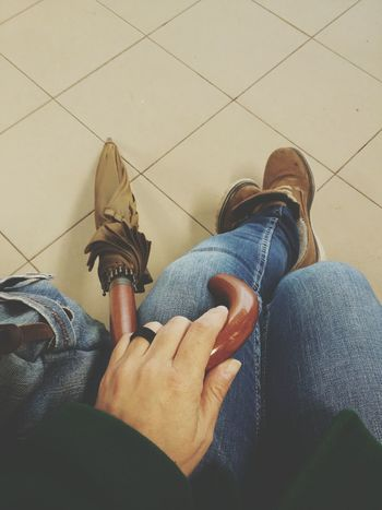 Hanging Out Sitting On A Bench Umbrella Floortraits Brown Boots Boots Jeans From My Point Of View Waiting For The Train Woman Hand Relaxing The Street Photographer – 2016 EyeEm Awards Geometric Shape EyeEm Gallery Floortrait Close-up EyeEm Best Shots
