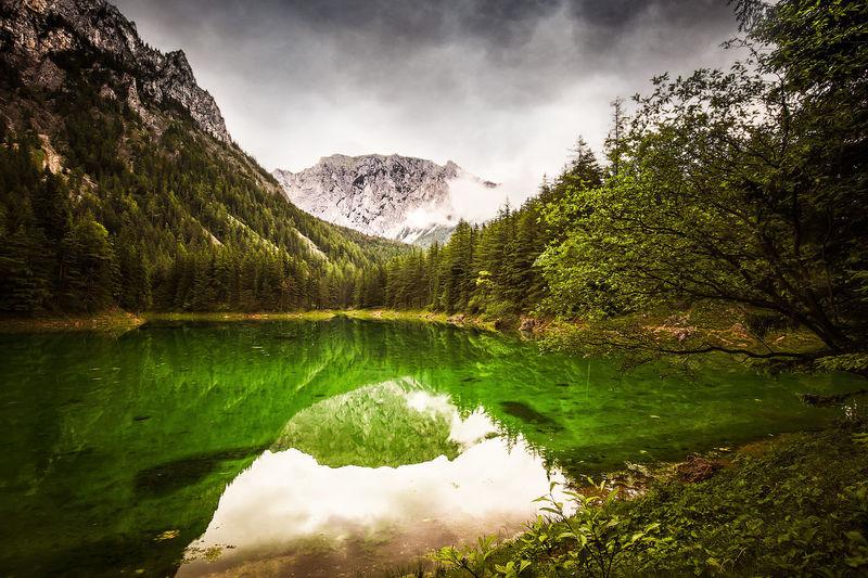 Idyllic shot of mountain reflection in gruner see