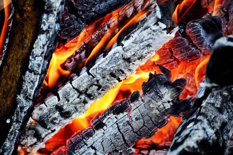 Orange Color Full Frame No People Outdoors Heat - Temperature Lava Nature Backgrounds Beauty In Nature Molten Hot Spring Wood - Material White Reflection Pattern Fire Fireplace Camp Fire Wood Tourism Summer Flames & Fire Burning Multi Colored Flame