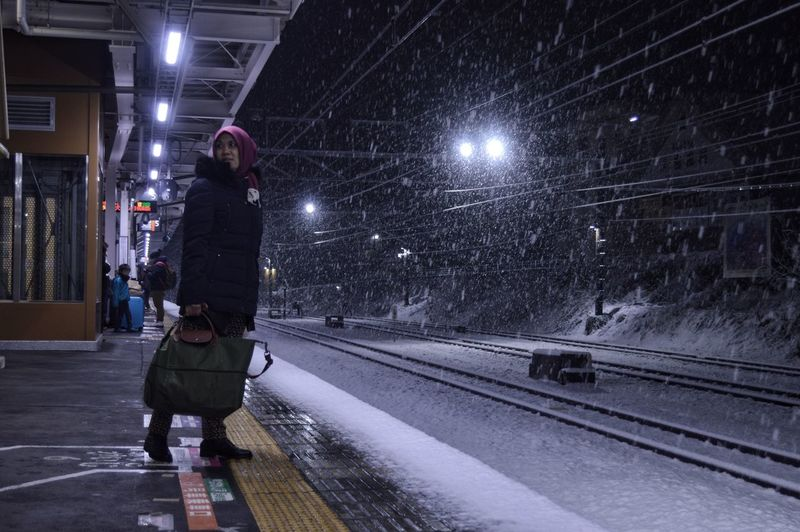 Adapted To The City in the station when the snow fall at Kawaguchi. Miles Away