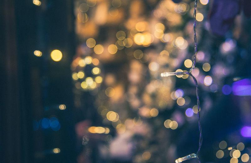Capture Tomorrow Illuminated Night Lens Flare Defocused No People Celebration Decoration Christmas Focus On Foreground Holiday Light - Natural Phenomenon Christmas Lights Lighting Equipment Glowing Christmas Decoration Tree Shape Close-up Outdoors Electricity  Light