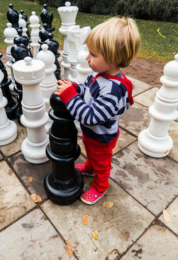 What's your next move? Hello World Blond Hair Chess Chess Board Chess Piece Childhood Day Full Length Leisure Games One Person Outdoors People Playing Real People Strategy
