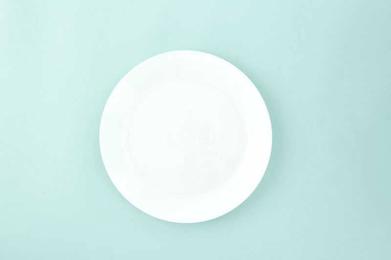 Empty plate on pastel pale blue background, with copy space. Flat lay. Art Abstract Sale Text Copy Space Family Party Sales Holiday Flyer Banner Poster Mockup Photo Autumn Falling Empty Space Plate Empty View Top Table Food Dish Above Round Object Wooden Wood Clean Copy Meal Blue Nobody Dishware Studio Single Directly Above Indoors  Studio Shot White Color Circle Colored Background Geometric Shape Shape Blue Background No People Single Object Close-up Cut Out Still Life High Angle View Empty Plate Crockery Turquoise Colored