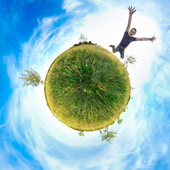 Jump of the planet 360 360camera 360° Blue Sky Capture The Moment Circle Cloud - Sky Day Field Fish-eye Lens Great Outdoors-EyeEm Awards 2017 Jumping Little Planet Low Angle View Men Nature One Person Outdoors Photosphere Real People Sky Summer Tree