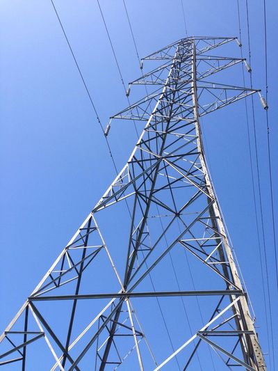 EyeEm Selects Built Structure Electricity Pylon Cable Blue Electricity  Clear Sky Connection Power Supply Tower Low Angle View Day No People Fuel And Power Generation Sky Architecture Outdoors Girder