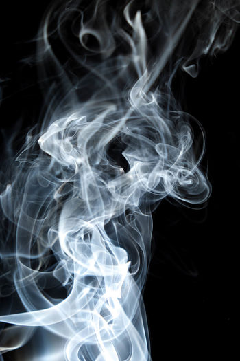 Abstract Black Background Burning Changing Form Close-up Complexity Curve Design Fragility Illuminated Incense Indoors  Luminosity Motion Nature No People Pattern Smoke - Physical Structure Studio Shot Swirl Vulnerability  White Color
