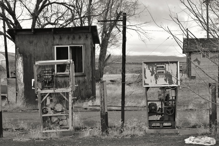 Old travel stop/convenience store/gas station structures in Termo, Lassen County, California, USA. Americana California Gas Pumps Lassen County USA Abandoned Architecture Black And White Building Exterior Built Structure Day Gasoline Pumps Ghost Town No People Outdoors Run-down Sky Termo Tree