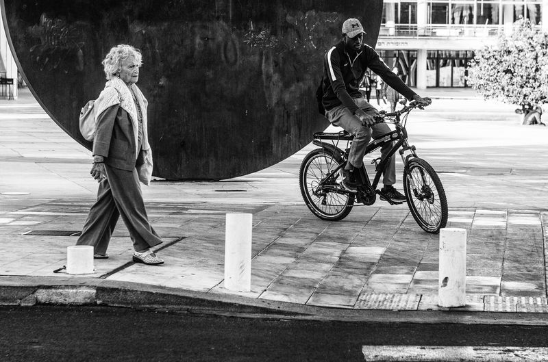 Community Diversity Gaps Adult Bicycle Black And White Friday Crossing Day Full Length Land Vehicle Looks Men Mode Of Transport Movement One Person Outdoors People Real People Street Photography Stunt Transportation Heavy And Light This Is Aging
