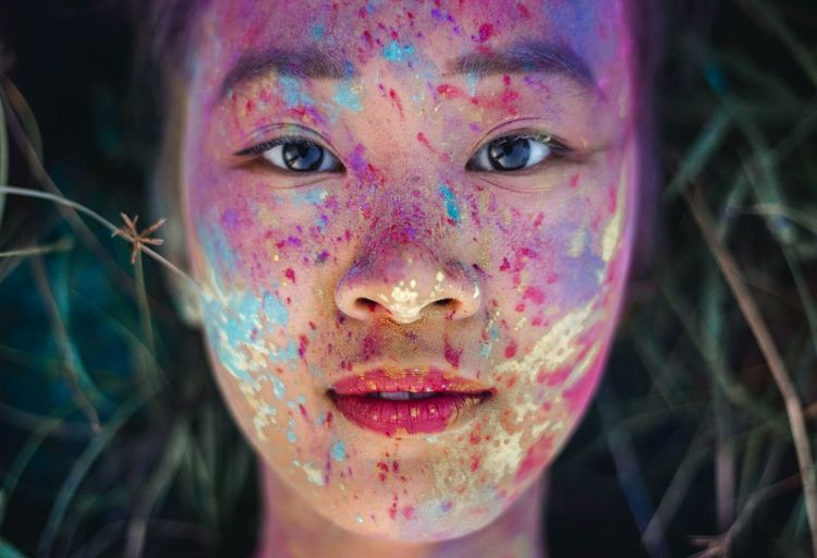 it's a beautiful world Portrait Portrait Of A Woman Portrait Photography Portrait Of A Girl Facial Expression Multi Colored Human Face Celebration Beauty Body Paint Women Of EyeEm Beautiful People Delicate Colour Colors Paint Paint Splatter Outdoors The Portraitist - 2017 EyeEm Awards
