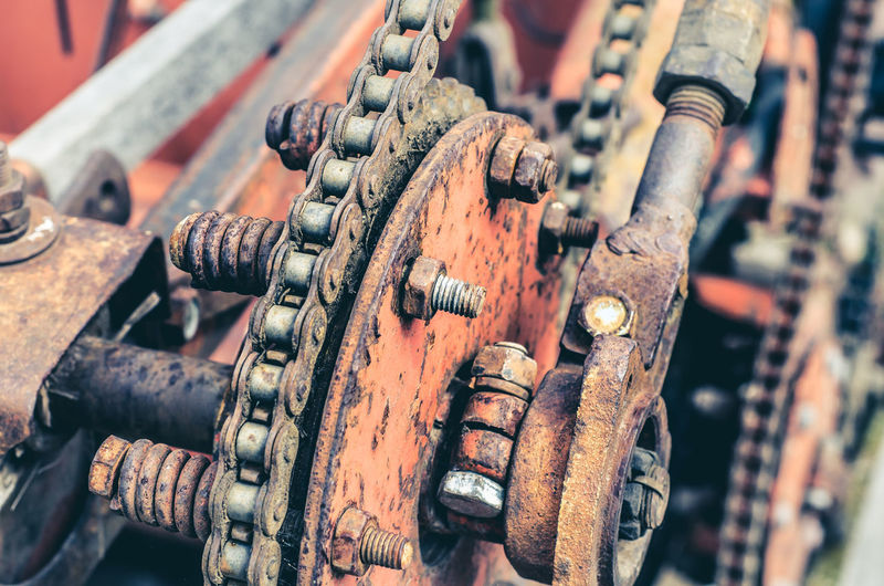 Parts of old broken machine under corrosion closeup. old technics. gears, chains.