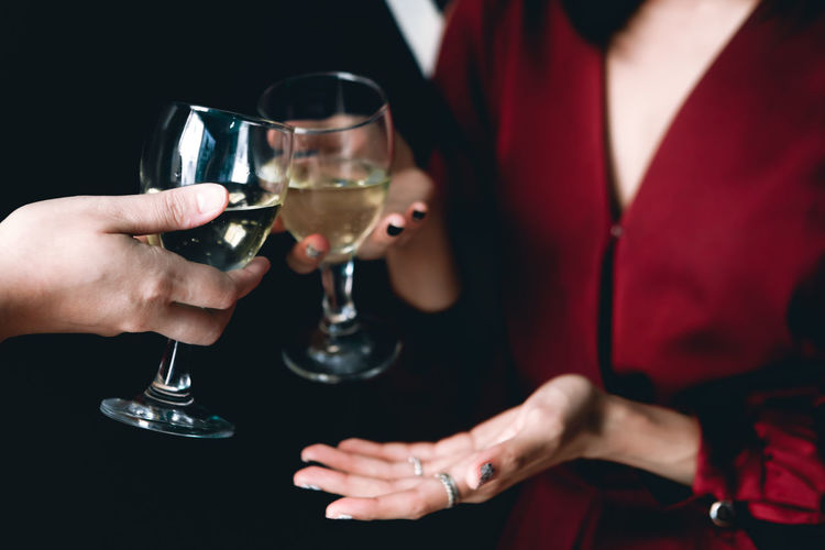 Adult Alcohol Celebration Celebratory Toast Drink Food And Drink Glass Hand Holding Human Body Part Human Hand Indoors  Lifestyles Men Midsection People Real People Refreshment Wine Wineglass Women