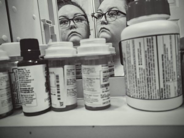 Medicine Mental Health  Black And White Portrait Of A Woman Portrait Mirror Growth Selective Focus Low Angle View Cold Temperature TCPM Medicine Bottle Medicines Black And White Photography Depression Female Mental Mental Illness Low Angle Indoors  Reflection Deep Thoughts