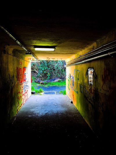 Tunnel EyeEm Best Shots EyeEm Gallery EyeEm Selects EyeEmNewHere Architecture No People Road The Way Forward Built Structure Transportation Graffiti Wall - Building Feature Multi Colored Direction Wet Street Rain Tunnel Illuminated Indoors  Creativity Communication City Lighting Equipment