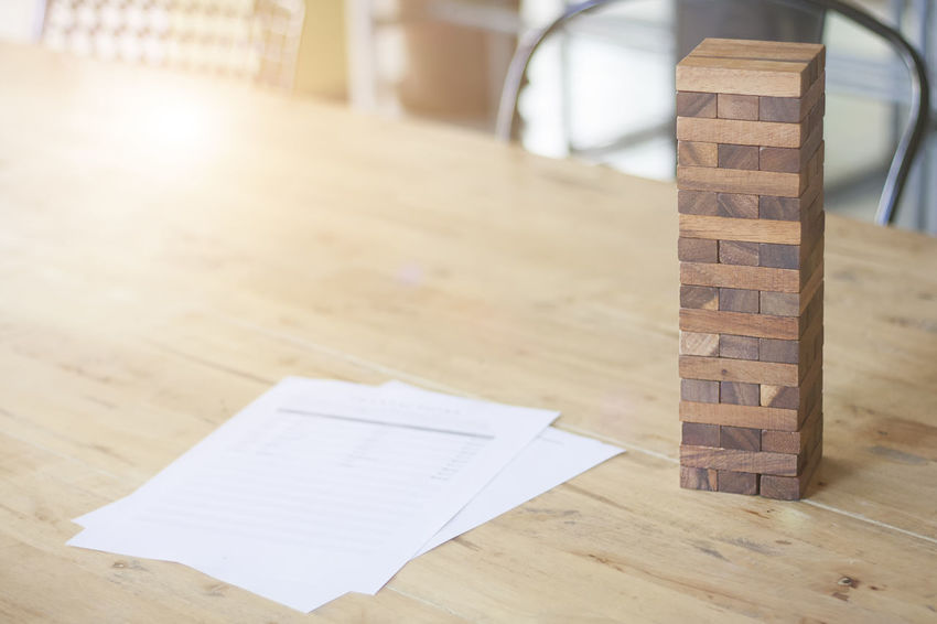 Blocks wood game on wooden table. Bunding Business Business Trip Close-up Consultation Day Ideas Indoors  No People Office Wood - Material Wooden Game Work