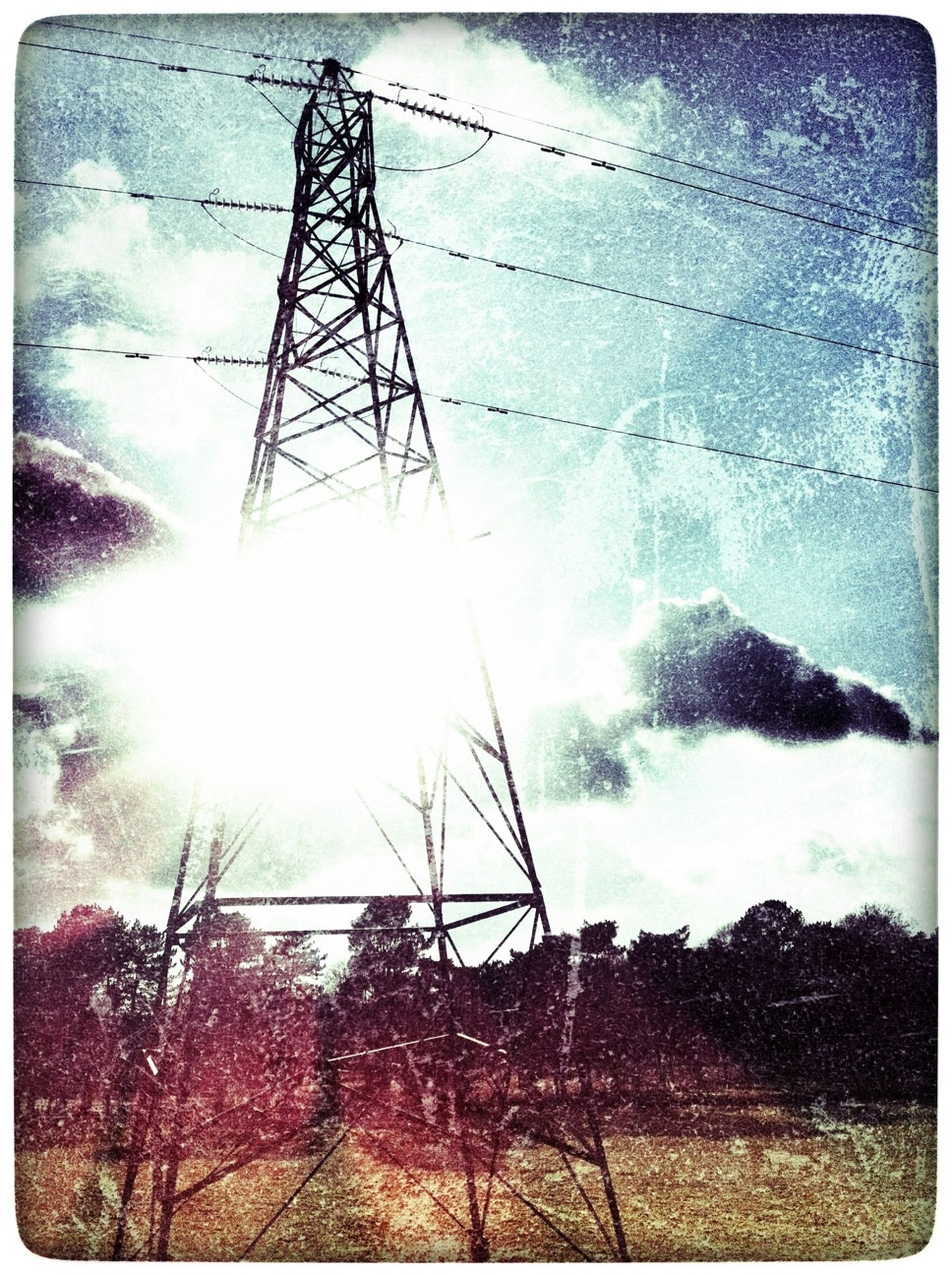 transfer print, auto post production filter, power line, electricity pylon, power supply, electricity, low angle view, sky, fuel and power generation, technology, connection, cable, cloud - sky, silhouette, sunlight, power cable, built structure, outdoors, no people, day