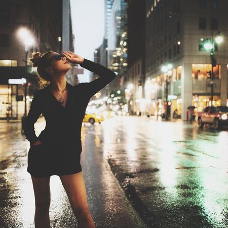 City One Person Street Architecture Building Exterior Lifestyles Standing City Life Wet Night Built Structure Women Real People Leisure Activity Young Women Three Quarter Length Casual Clothing Road Rain Young Adult