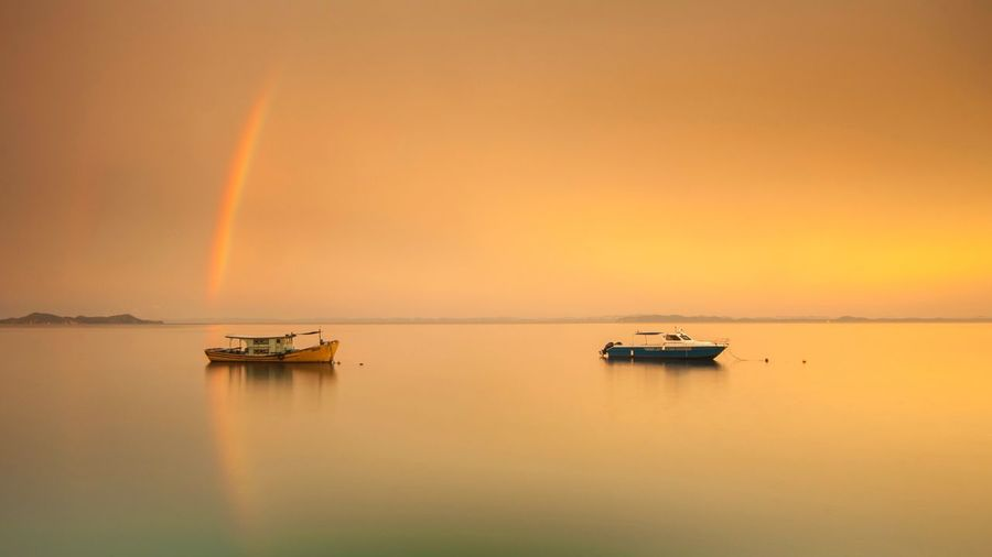 Sunrise with rainbow Sunset Background Beachphotography Seascape Sunrise Water Sky Sunset Scenics - Nature Beauty In Nature Orange Color Tranquility Romantic Sky Nature Sea Tranquil Scene Reflection No People Horizon Over Water Outdoors