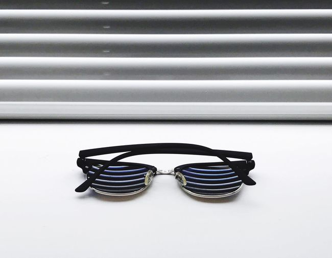 Sunglasses Still Life Striped No People Fashion Close-up Indoors  Day Blinds Sunglasses Sun Light Light And Shadow White Fresh On Market 2017