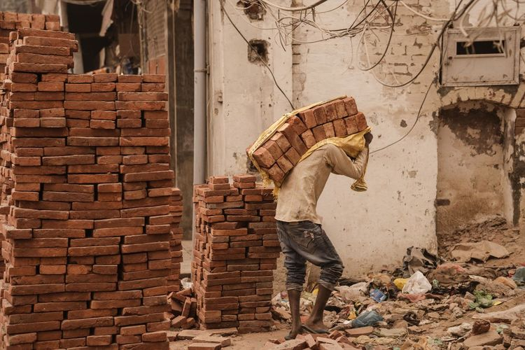 Man working on brick wall