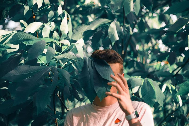 Young adult lost in Forest Lost Leaves Trees Cool Funny Plant Part Leaf One Person Leisure Activity Growth Real People Plant Young Adult Nature Headshot Portrait Outdoors Standing Green Color Day Young Men Adult Lifestyles Young Women Obscured Face The Portraitist - 2018 EyeEm Awards
