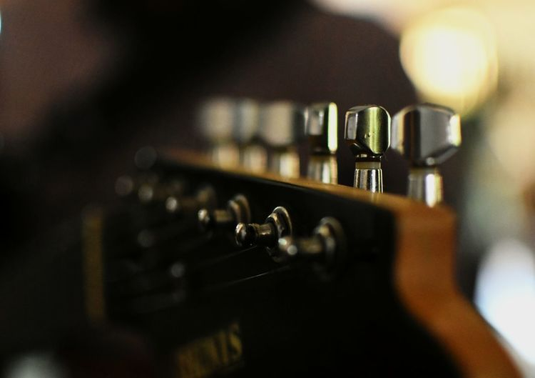 Close-up of guitar knobs