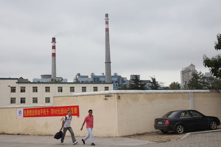 Two men walking by a car,Qingdao,China,2010. Factory Chimneys 2016 EyeEm Awards Chimney China China 2010 City Landscape Cloud - Sky Hello World Here Belongs To Me My Favorite Photo Qingdao China Snapshots Of Life From My Point Of View Fine Art Photography