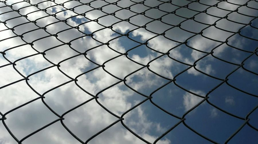 Zaun im Kopf Chainlink Fence Protection Security Metal No People Full Frame Backgrounds Outdoors Nature Pattern Day Safety Sky Clouds Low Angle View Fence Fenced In Border Geometric Shape Geometry Pattern Metalwork Symbol Symbolism The Graphic City