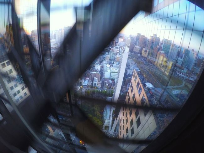 OSAKA Cityscape In The Elevator From My Point Of View Capture The Moment Window Reflections Windows Reflection Light And Shadow Buildings & Sky Architecture Building Exterior Lines And Shapes Lines, Shapes And Curves Umeda Sky Building 梅田スカイビル EyeEm Best Shots EyeEm Best Edits