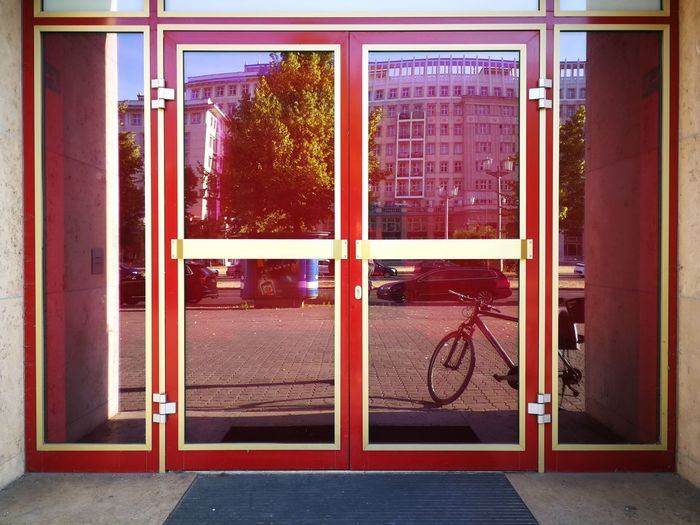Exterior of building seen through glass window