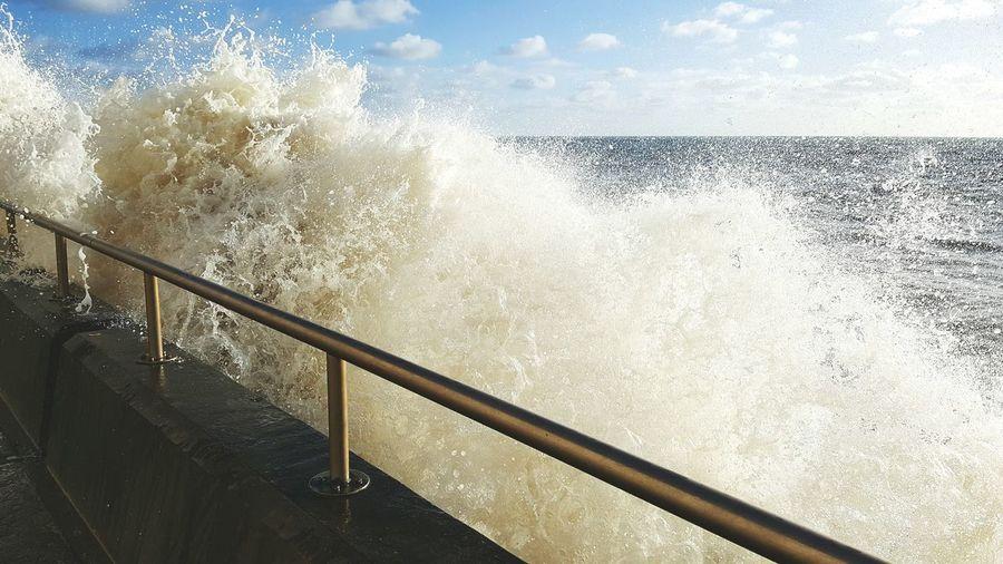 Waves Splashing On Railing At Brighton Beach