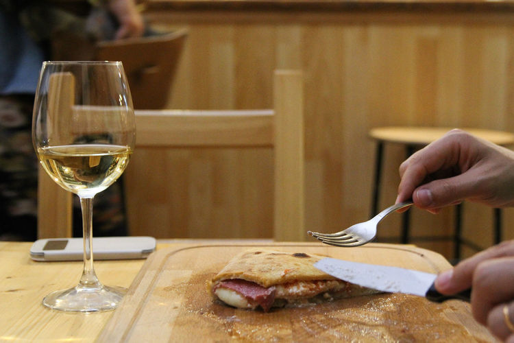 Pizza Calzone Italian Food Italy Human Hand Wineglass Wine Holding Close-up Food And Drink Leftovers Empty Plate Table Knife Place Setting Silverware  Eaten Knife Fork Napkin Eating Utensil Setting The Table Prepared Food