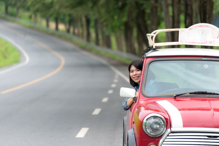 Side view of woman on road