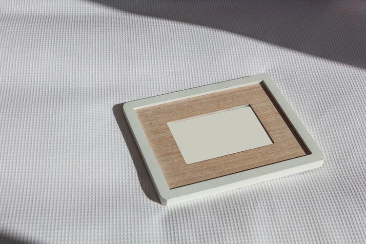 High angle view of picture frame on table