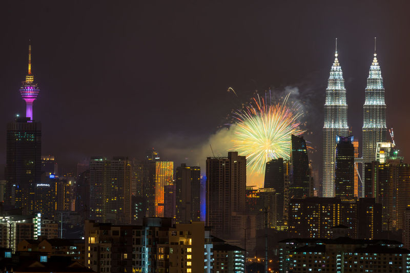 High angle view of firework display over cityscape
