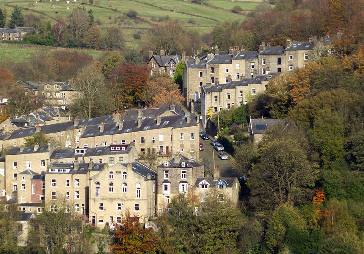 terraced steep streets in hebden bridge west yorkshire Hebden Bridge Yorkshire Architecture Autumn Building Exterior Built Structure Community Day Detached House High Angle View House Nature No People Outdoors Residential Building Roof Sky Town Tree