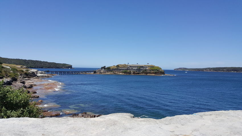 difference view of Bare Island from LaPerouse check point Cliff Bare Island La Perouse Sunlight Windy Sky Island Bridge - Man Made Structure Clear Sky Blue Sea And Clear Water Blue Sea And Blue Sky