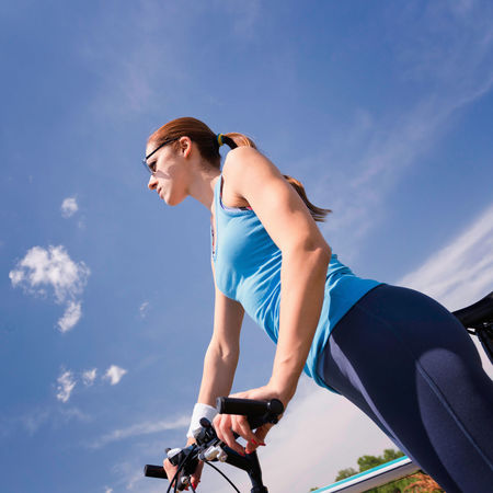 Young Woman With Bicycle Caucasian Ethnicity, Daytime Lifestyle Mountain Bike Square Standing Sunlight Sunny Activity Attractive Woman Bicycle Blue Blue Sky Break Clouds Day Female Healthy Lifestyle Mountain Biking Outdoors Riding Sky Sport Sports Clothing Tilted