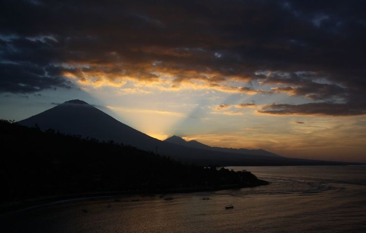 Bali Mt Agung Beauty In Nature Before The Storm Cloud - Sky Heavens Idyllic Landscape Lazy Afternoon Mountain Mountain Range Nature No People Outdoors Scenics Silhouette Sky Sunset Tranquil Scene Tranquility Volcanic Landscape Water EyeEmNewHere An Eye For Travel