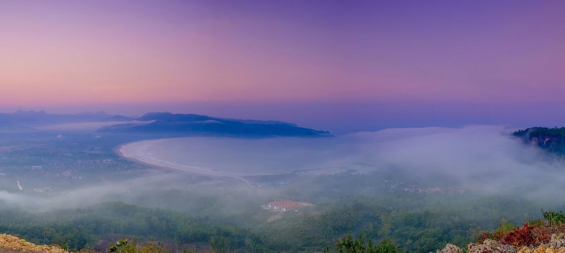 Fog attack from the Hindia Ocean Pacitan Astana Genthong Sentono Genthong Surfing Bay Beauty In Nature Scenics - Nature Sky Environment Plant Mountain Nature Tree Tranquility Cloud - Sky Land No People Sunset Outdoors Idyllic Non-urban Scene Purple Landscape Fog Tranquil Scene The Traveler - 2018 EyeEm Awards