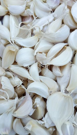 Full frame shot of garlic cloves for sale at market