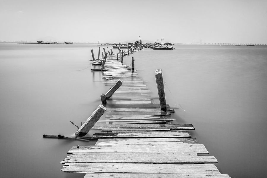 Overflow broken wooden bridge view Classic Overflow Print Blacckandwhite Black And White Bridge Clear Sky Commercial Dock Day Harbor Jetty Moored Nature Nautical Vessel No People Outdoors Pier Scenics Sea Sky Tranquil Scene Tranquility Village Water Wooden