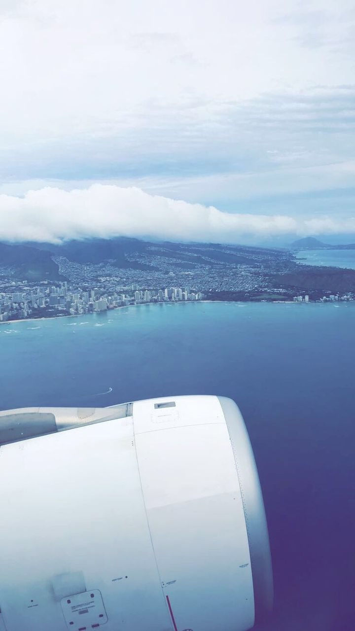 aerial view, sea, airplane, sky, water, no people, cloud - sky, beauty in nature, nature, scenics, journey, transportation, cityscape, day, air vehicle, airplane wing, outdoors, horizon over water, city, flying, close-up