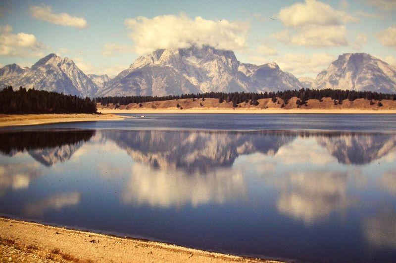Mountains reflecting on calm lake