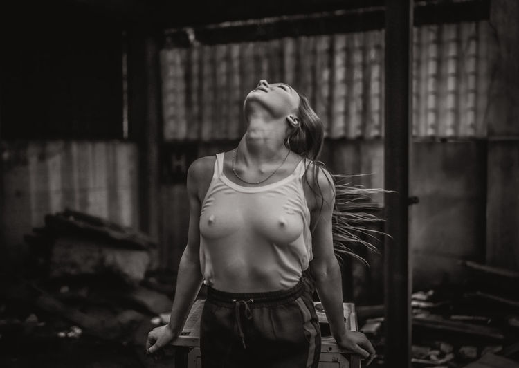 Sensuous Woman Standing In Abandoned Building