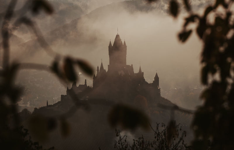 Sunrise on an autumn day at the Reichsburg Cochem in Cochem, Germany Architecture Built Structure Building Exterior Travel Destinations Travel No People Outdoors Autumn Autumn colors Cochem Cochem Castle Cochem An Der Mosel Mosel Sunrise Morning Clouds Moody Sky Mood Leaves Trees Castle Middle Ages Old Fairytale