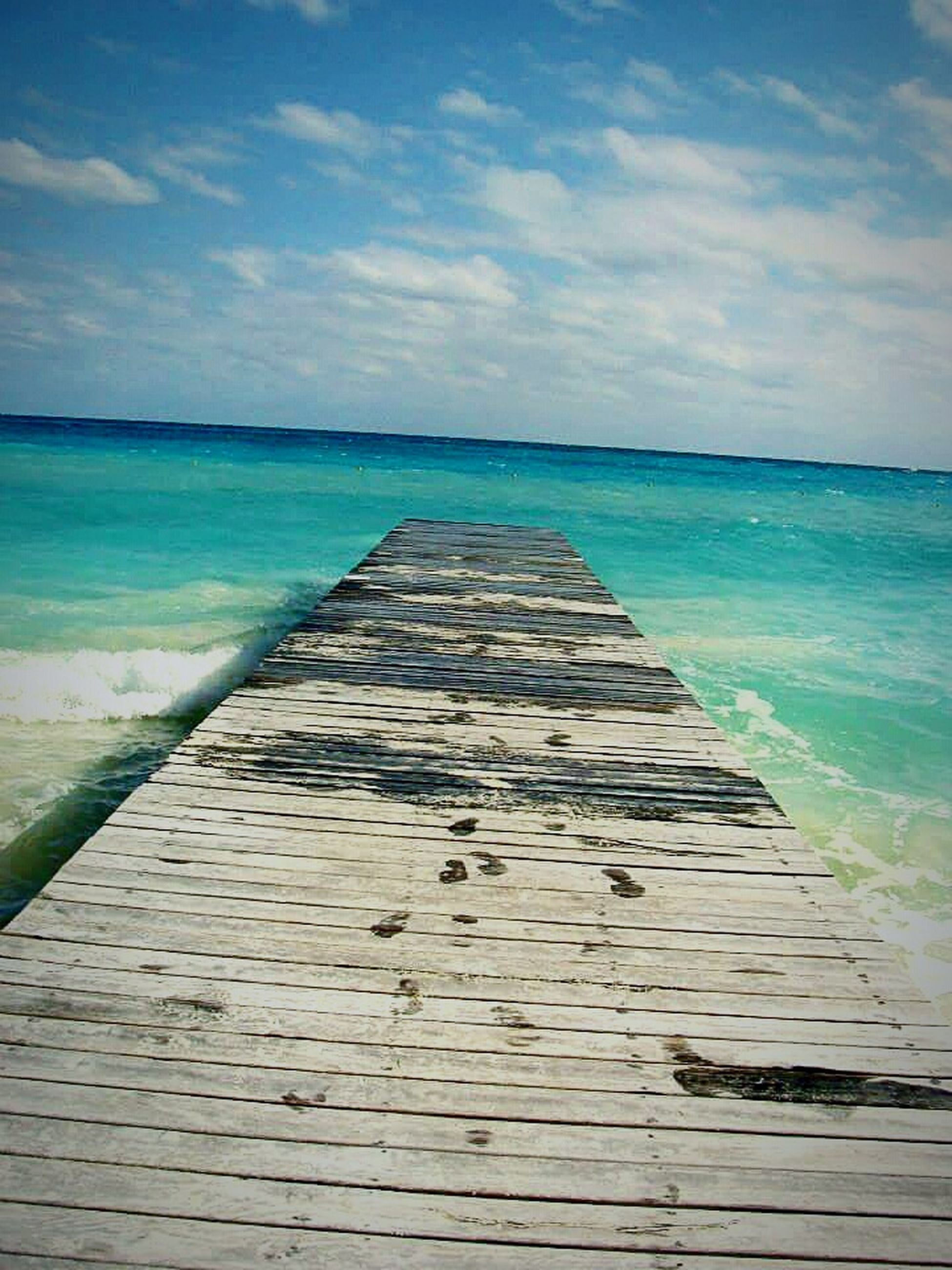 sea, horizon over water, water, the way forward, sky, beach, blue, tranquil scene, tranquility, scenics, diminishing perspective, pier, beauty in nature, nature, shore, cloud, cloud - sky, idyllic, day, boardwalk