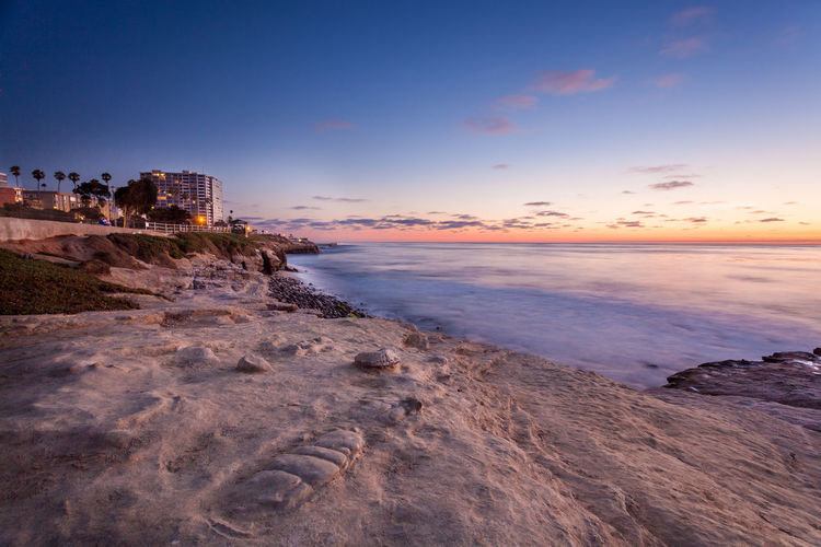 La Jolla Cove at Sunset San Diego Architecture Beach Beauty In Nature Building Exterior Built Structure Cloud - Sky Horizon Horizon Over Water La Jolla La Jolla Cove Land Nature No People Outdoors Rock Scenics - Nature Sea Sky Sunset Tranquil Scene Tranquility Water