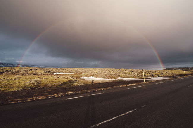 rainbow over road against sky Copy Space Iceland Iceland Memories Mountain View Nature Photography Nordic Light Stormy Weather Travel Photography Beauty In Nature Cloud - Sky Direction Double Rainbow Environment Iceland Trip Idyllic Landscape Mountain Mountain Range Nature No People Non-urban Scene Nordic Nordic Winter Outdoor Photography Outdoors Philipp Dase Rain Rainbow Road Scenics - Nature Sky Stormy Sky Street The Way Forward Tranquil Scene Tranquility Transportation
